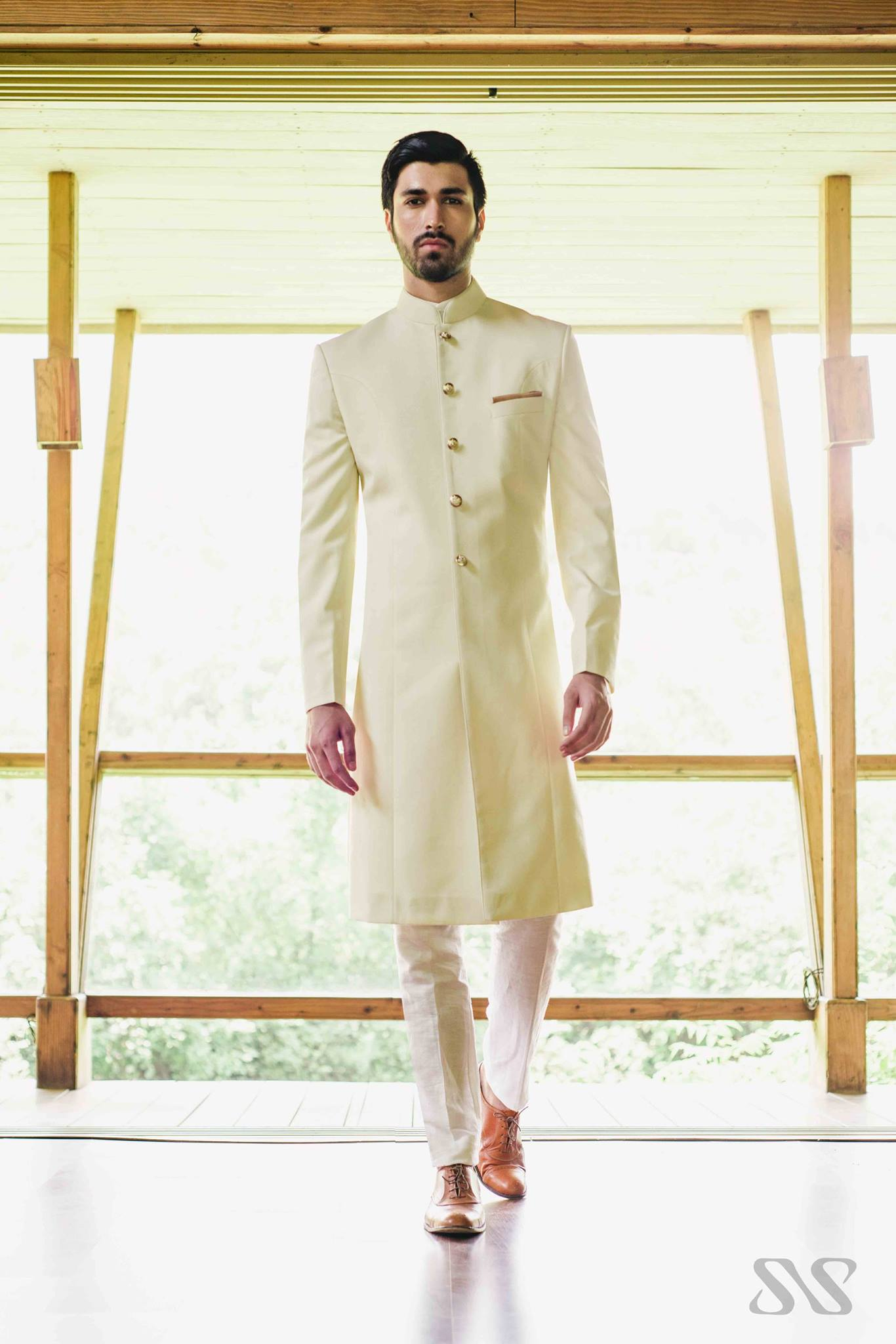 groom in off white